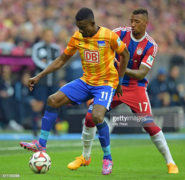 Salomon Kalou of Hertha BSC handles the ball against Jerome Boateng of Bayern Muenchen during the game FC Bayern Muenchen against Hertha BSC on april...