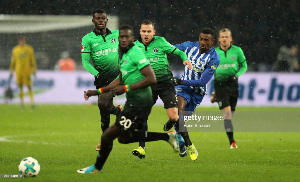 Salomon Kalou of Hertha BSC is challenged by Marvin Bakalorz of Hannover 96 and Salif Sane of Hannover 96 during the Bundesliga match between Hertha BSC and Hannover 96 at Olympiastadion on December 13, 2017 in Berlin, Germany.