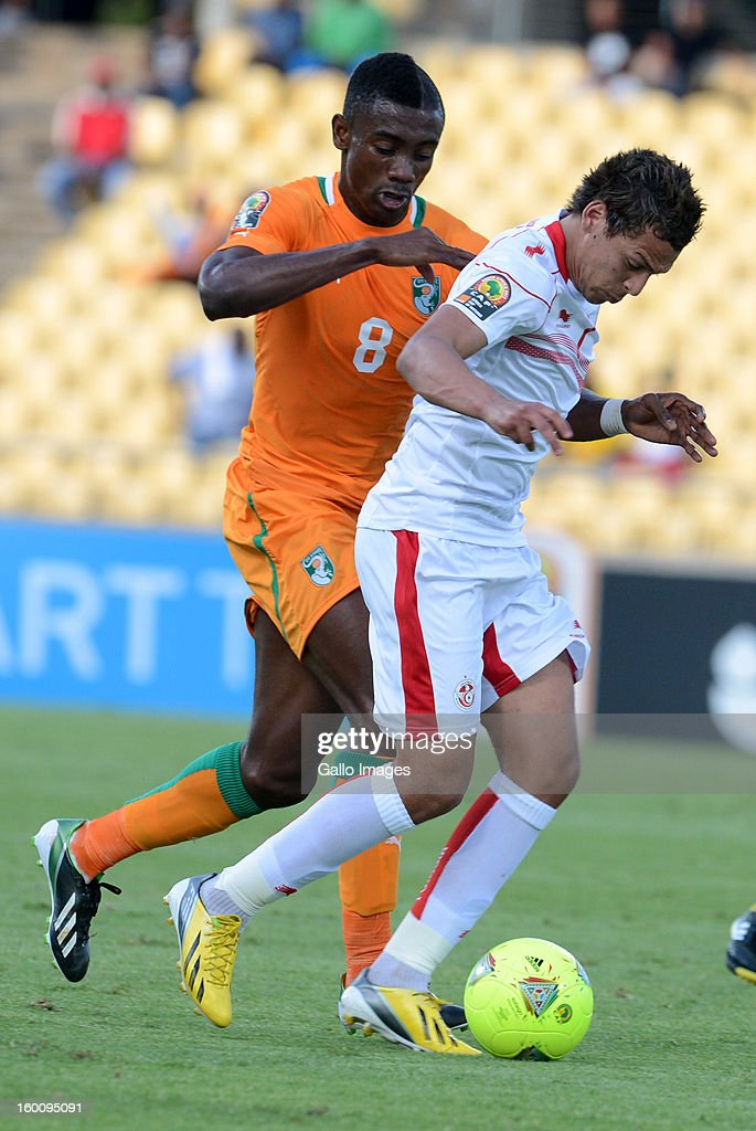Salomon Kalou of Ivory Coast and Youssef M'sakni of Tunisia during the 2013 African Cup of Nations match between Ivory Coast and Tunisia at Royal Bafokeng Stadium on January 26, 2013 in Rustenburg, South Africa.
