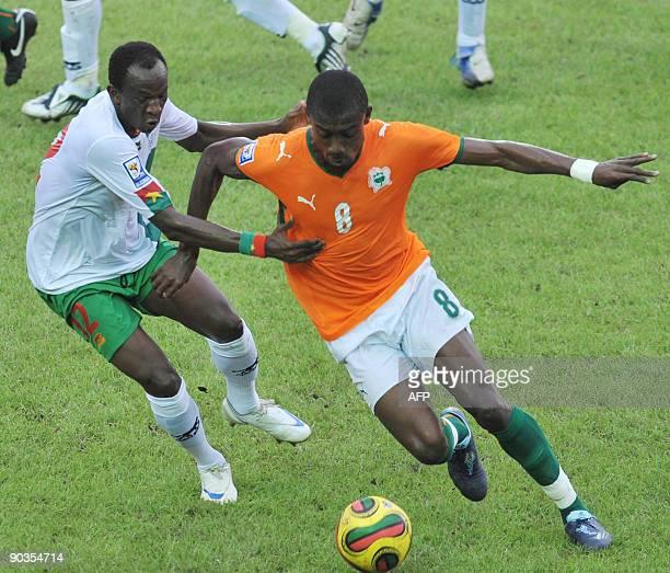Salomon Kalou of 'The Elephants' the Ivory Coast's national football team vies with Saidou Madi Panandetiguiri of Burkina Faso on September 5 2009 in...
