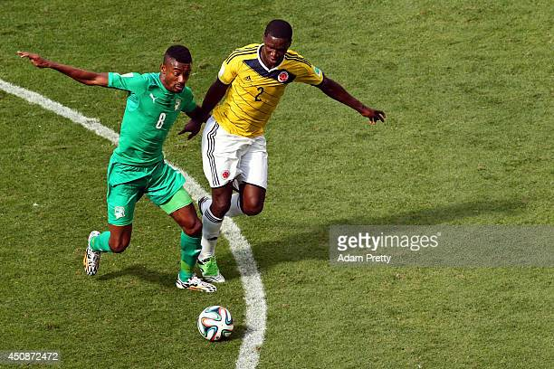 Salomon Kalou of the Ivory Coast and Cristian Zapata of Colombia compete for the ball during the 2014 FIFA World Cup Brazil Group C match between...