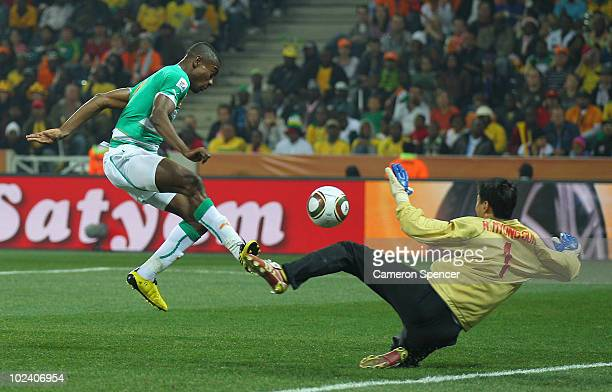 Salomon Kalou of the Ivory Coast scores his side's third goal past Ri MyongGuk of North Korea during the 2010 FIFA World Cup South Africa Group G...