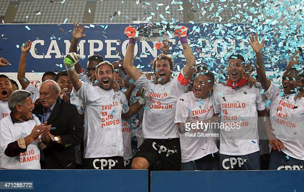 Salomon Libman of Cesar Vallejo holds the Copa Torneo del Inca 2015 trophy after winning match between Alianza Lima and Cesar Vallejo as part of...