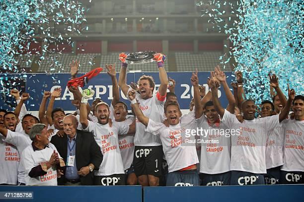 Salomon Libman of Cesar Vallejo lift the Copa Torneo del Inca 2015 trophy after winning match between Alianza Lima and Cesar Vallejo as part of...