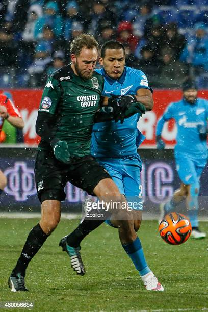 Salomon Rondon of FC Zenit St Petersburg and Andreas Granqvist of FC Krasnodar vie for the ball during the Russian Football League Championship match...