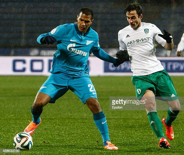 Salomon Rondon of FC Zenit St Petersburg and Mauricio of FC Terek Grozny vie for the ball during the Russian Football League Championship match...
