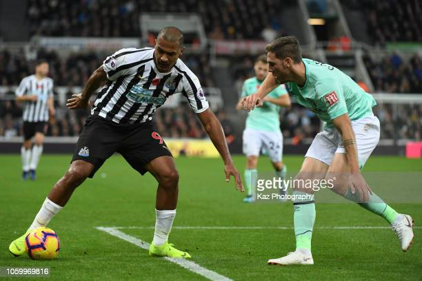 Salomon Rondon of Newcastle keeps the ball under the pressure from Dan Gosling of Bournmouth during the Premier League match between Newcastle United...
