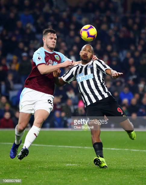 Salomon Rondon of Newcastle United and Kevin Long of Burnley battle for possession during the Premier League match between Burnley FC and Newcastle...
