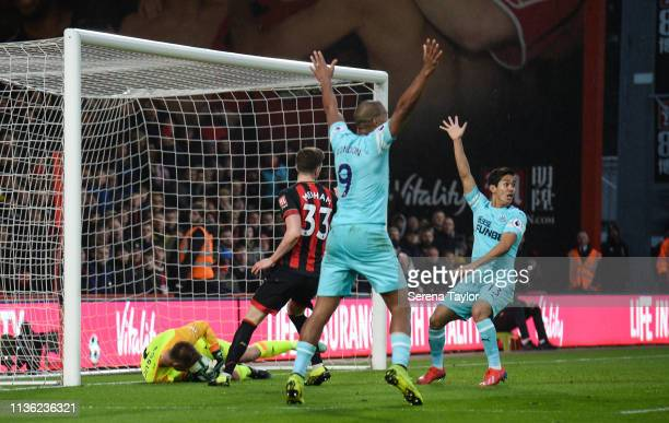Salomon Rondon of Newcastle United and Yoshinori Muto shout for a back pass during the Premier League match between AFC Bournemouth and Newcastle...