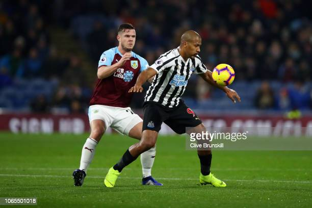 Salomon Rondon of Newcastle United battles for possession with Kevin Long of Burnley during the Premier League match between Burnley FC and Newcastle...