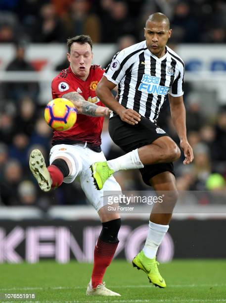 Salomon Rondon of Newcastle United battles for possession with Phil Jones of Manchester United during the Premier League match between Newcastle...