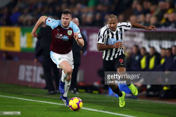 Salomon Rondon of Newcastle United battles with Kevin Long of Burnley during the Premier League match between Burnley FC and Newcastle United at Turf...