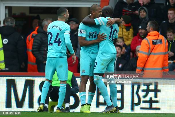 Salomon Rondon of Newcastle United celebrates after scoring his team's first goal with Miguel Almiron and Mohamed Diame of Newcastle United during...