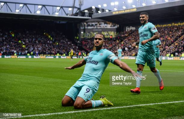 Salomon Rondon of Newcastle United celebrates with DeAndre Yedlin after scoring the opening goal during the Premier League match between Watford FC...