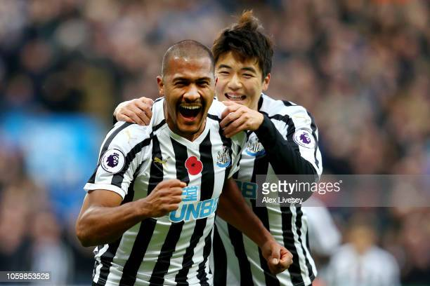 Salomon Rondon of Newcastle United celebrates with teammate Ki SungYeung after scoring his team's first goal during the Premier League match between...