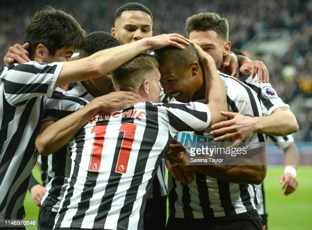 Salomon Rondon of Newcastle United celebrates with teammates after scoring Newcastle's second equalising goal during the Premier League match between...