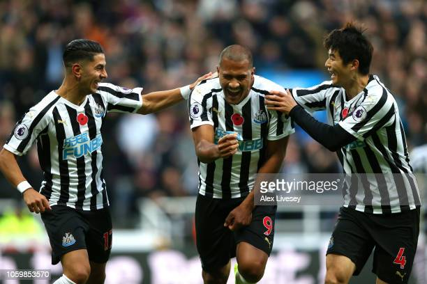 Salomon Rondon of Newcastle United celebrates with teammates Ayoze Perez and Ki SungYeung after scoring his team's first goal during the Premier...