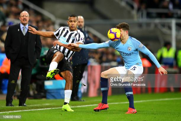 Salomon Rondon of Newcastle United kicks the ball in the face of John Stones of Manchester City during the Premier League match between Newcastle...