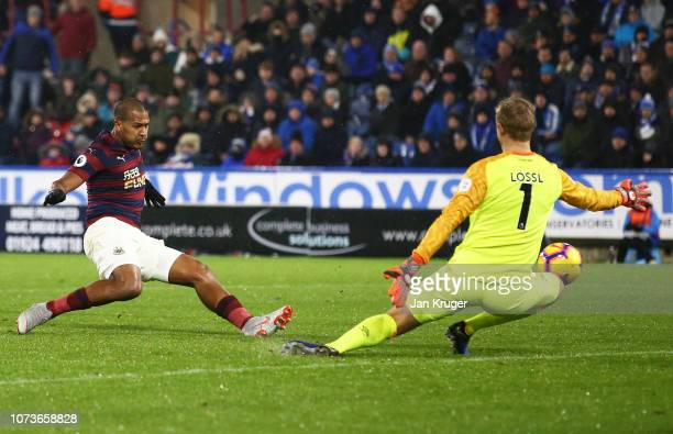 Salomon Rondon of Newcastle United scores his team's first goal during the Premier League match between Huddersfield Town and Newcastle United at...