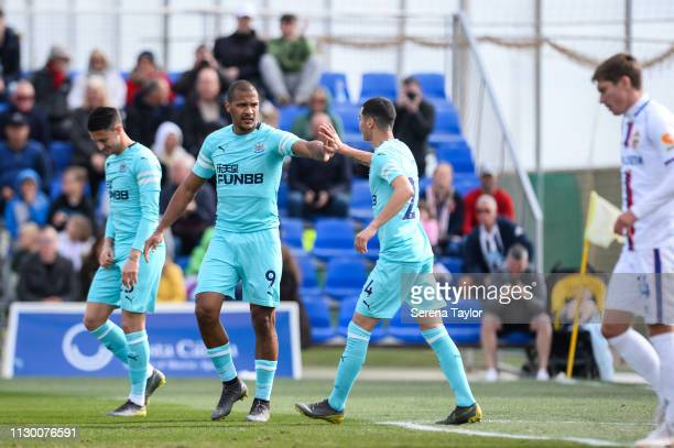 Salomon Rondon of Newcastle United shakes hands with Miguel Almiron after scoring the opening goal during the friendly match between Newcastle United...