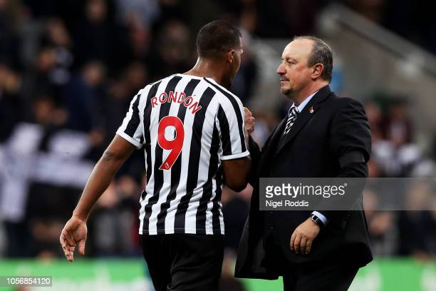 Salomon Rondon of Newcastle United shakes hands with Rafael Benitez Manager of Newcastle United at the end of the match after the Premier League...