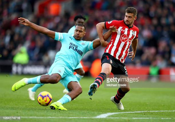 Salomon Rondon of Newcastle United shoots under pressure from Jack Stephens of Southampton during the Premier League match between Southampton FC and...