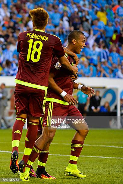 Salomon Rondon of Venezuela celebrates with his teammate Adalberto Penaranda during a group C match between Uruguay and Venezuela at Lincoln...