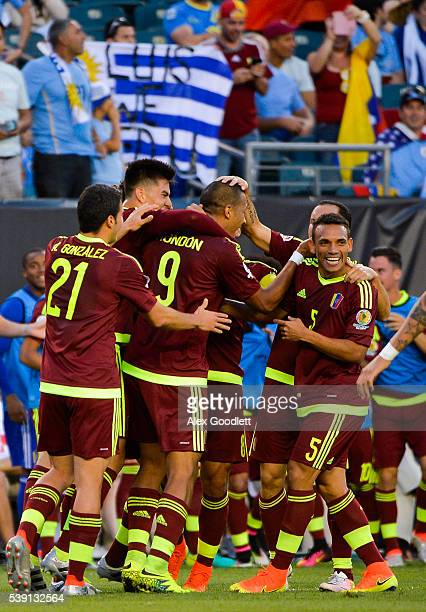 Salomon Rondon of Venezuela celebrates with his teammates after scoring a goal during a group C match between Uruguay and Venezuela at Lincoln...