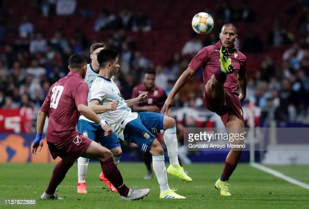Salomon Rondon of Venezuela controls the ball as Gonzalo Martinez of Argentina looks on during the International Friendly match between Argentina and...