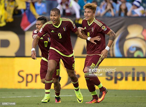 Salomon Rondon of Venezuela reacts after his goal along with Josef Martinez and Adalberto Penaranda against Uruguay during the 2016 Copa America...