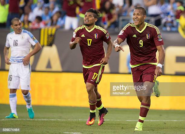 Salomon Rondon of Venezuela reacts after his goal along with Josef Martinez and in front of Maximiliano Pereira of Uruguay during the 2016 Copa...