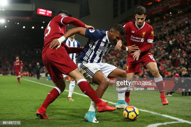 Salomon Rondon of West Bromwich Albion battles for the ball with Emre Can and Philippe Coutinho of Liverpool during the Premier League match between...