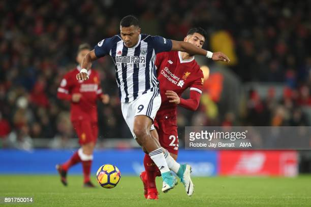 Salomon Rondon of West Bromwich Albion competes with Emre Can of Liverpool during the Premier League match between Liverpool and West Bromwich Albion...