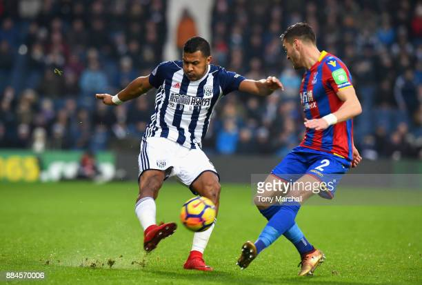 Salomon Rondon of West Bromwich Albion crosses the ball past Joel Ward of Crystal Palace during the Premier League match between West Bromwich Albion...
