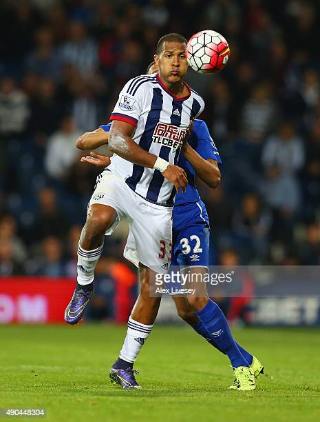 Salomon Rondon of West Bromwich Albion holds off Brendan Galloway of Everton during the Barclays Premier League match between West Bromwich Albion...