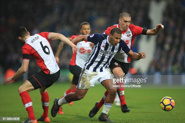 Salomon Rondon of West Bromwich Albion in action with Wesley Hoedt and Oriol Romeu of Southampton during the Premier League match between West...