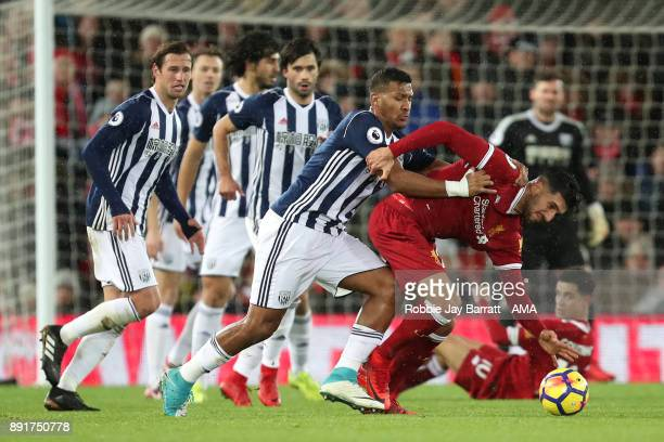 Salomon Rondon of West Bromwich Albion tangles with Emre Can of Liverpool during the Premier League match between Liverpool and West Bromwich Albion...
