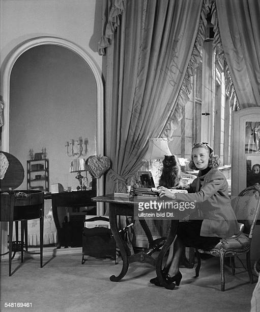 Salon of Berlin modiste and hatter Madame Berthe - 1941 - Photographer: Regine Relang - Published by: 'Die Dame' 13/1941 Vintage property of ullstein...