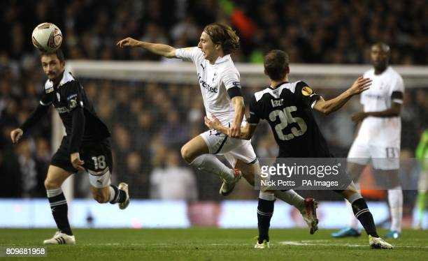 Salonika's Costin Lazar catches Tottenham Hotspur's Luka Modric as they battle for the ball