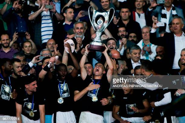 Salonika's Dimitris Pelkas celebrates with the trophy after the victory the Greek Cup final football match between AEK FC and PAOK Salonika at the...