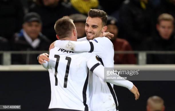 Saloniki's Robert Mak and Giannis Mystakidis celebrate during the Europa League group C soccer match Borussia Dortmund vs PAOK Saloniki in Dortmund...