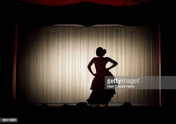 salsa dancer at a performance behind curtian - danse latine photos et images de collection