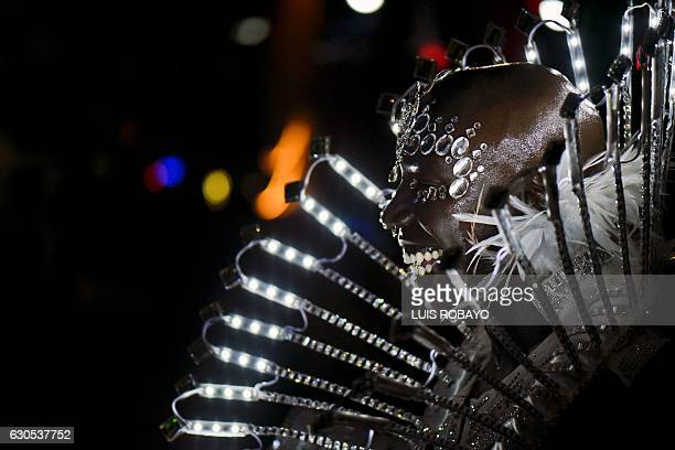 A salsa dancer performs during the 'Salsodromo' 2016 parade in Cali Colombia on December 25 2016 Some 1000 dancers from different salsa schools of...