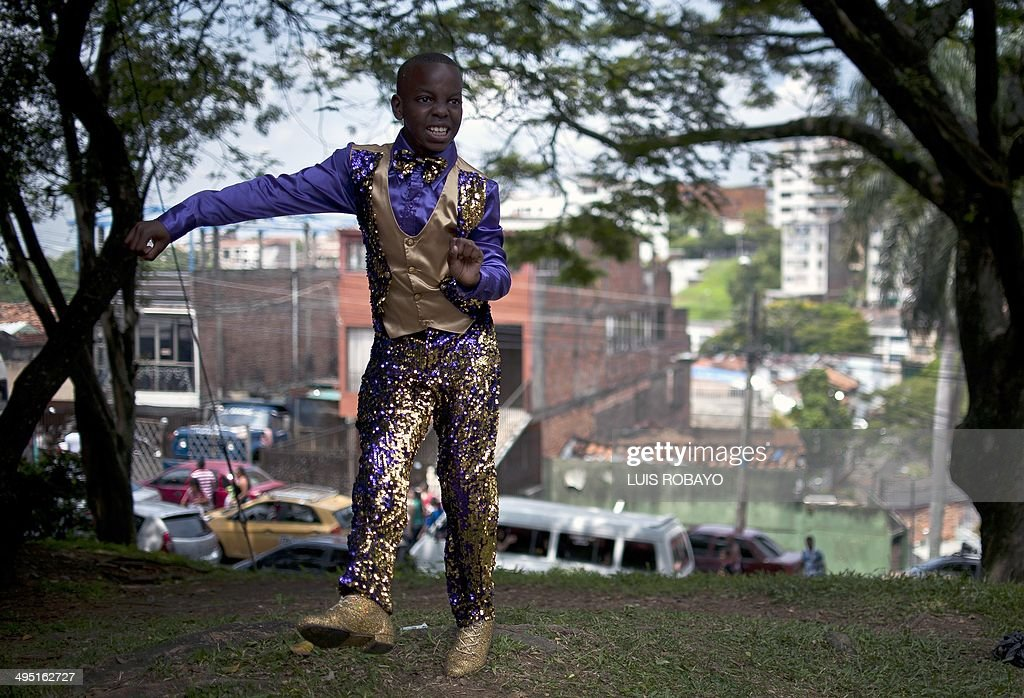 A salsa dancer practices before his presentation during the 'Mundialito de salsa', on June 1, 2014, in Cali, Valle del Cauca department, Colombia. 'Mundialito de salsa' is held prior to the World Salsa Festival and children between four and 13 years old are taking part. AFP PHOTO/Luis ROBAYO