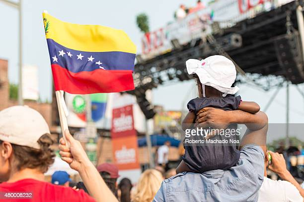 WEST TORONTO ONTARIO CANADA Salsa on St Clair Ave West The Venezuela flag present in the festival main stage besides a child in her father's...