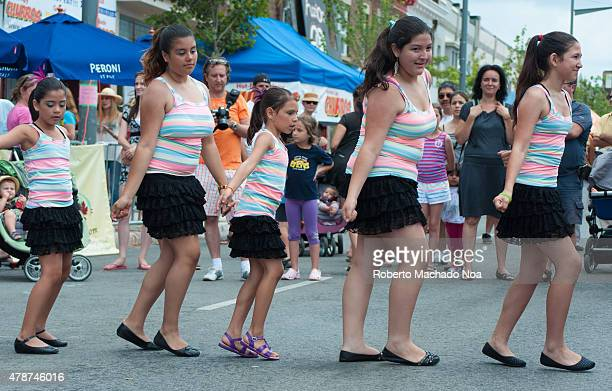 STREET TORONTO ONTARIO CANADA Salsa on St Saint Clair Festival Scenes Children girl in colored shirts and black skirt dancing in the street A crowd...