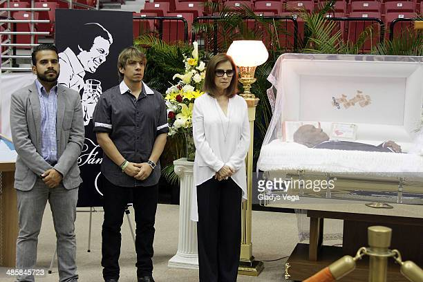 Salsa singer Gerardo Rivas songwriter Jose Hernandez and singer Nydia Caro stand guard at the funeral service for Cheo Feliciano at Coliseo Roberto...