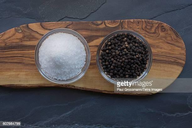 Salt and pepper on wood