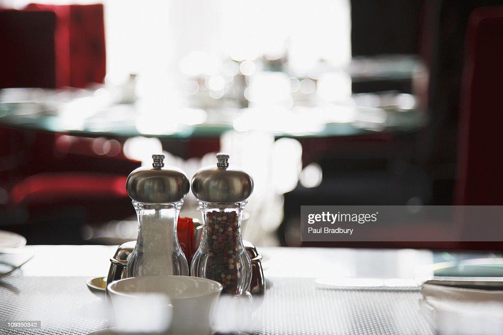 Salt and pepper shakers on restaurant table : Stock Photo