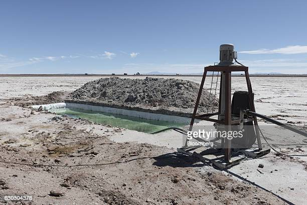 Salt brine is pumped from under the Salar de Uyuni into evaporation pools during the process of lithium production at the Llipi Pilot Plant in Potosi...